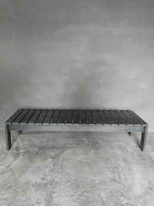 A black wooden slated bench