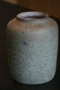 A blue and green ceramic vase