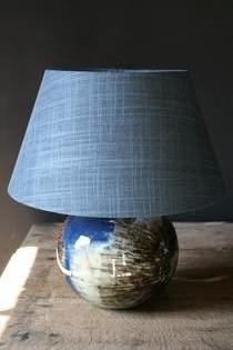A ceramic small table lamp with bleu grey shade