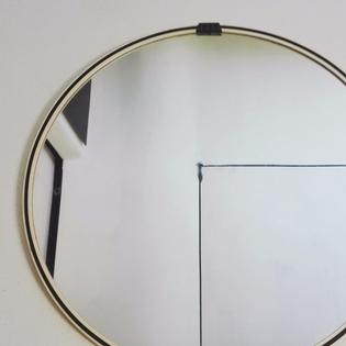 A circular original black and white mirror