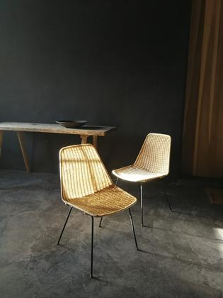 A pair of rotan and black steal seats