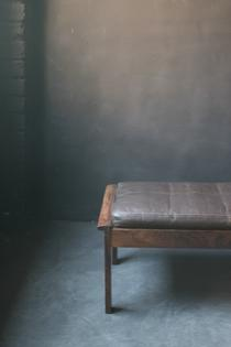 A palissander stool with nicely patinated leather cushion