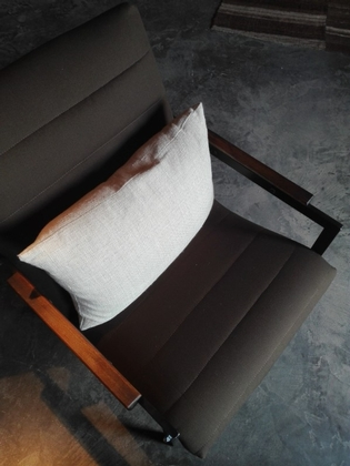 A Pierre Guariche lounge chair, newly upholsterd