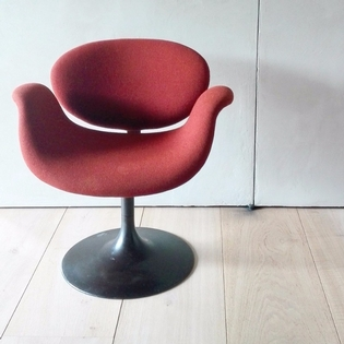 A Pierre Paulin tulip chair, orange fabric, black metal disc