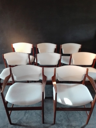 a set of 8 diningchairs by Kofod Larsen comprising two armchairs and 6 chairs, newly recoverd with white coton