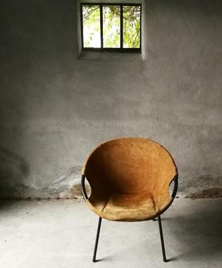 A suede balloon chair by Lush&Co