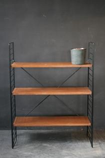 A Tomado black metal and wooden etagère
