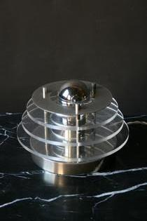 A vintage aluminium and plexi table lamp
