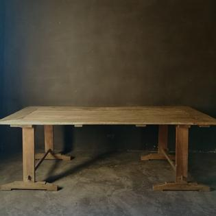 An antique pine trestle table