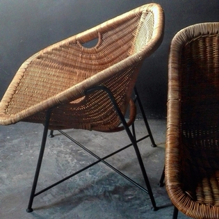 Pair of rotan and black metal armchairs, French