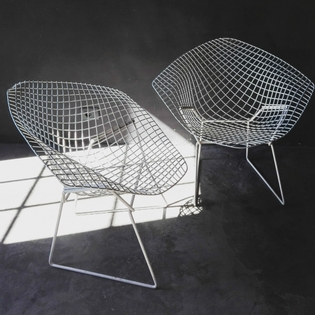 Pair of white Bertoia diamond chairs
