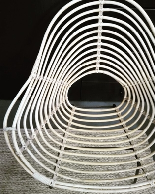 Rotan armchair by Rohe
