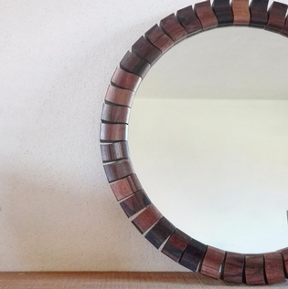 Small unusual rosewood mirror
